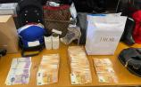 Rolex watches, designer clothes and champagne among the near-150 high end goods seized in garda raid