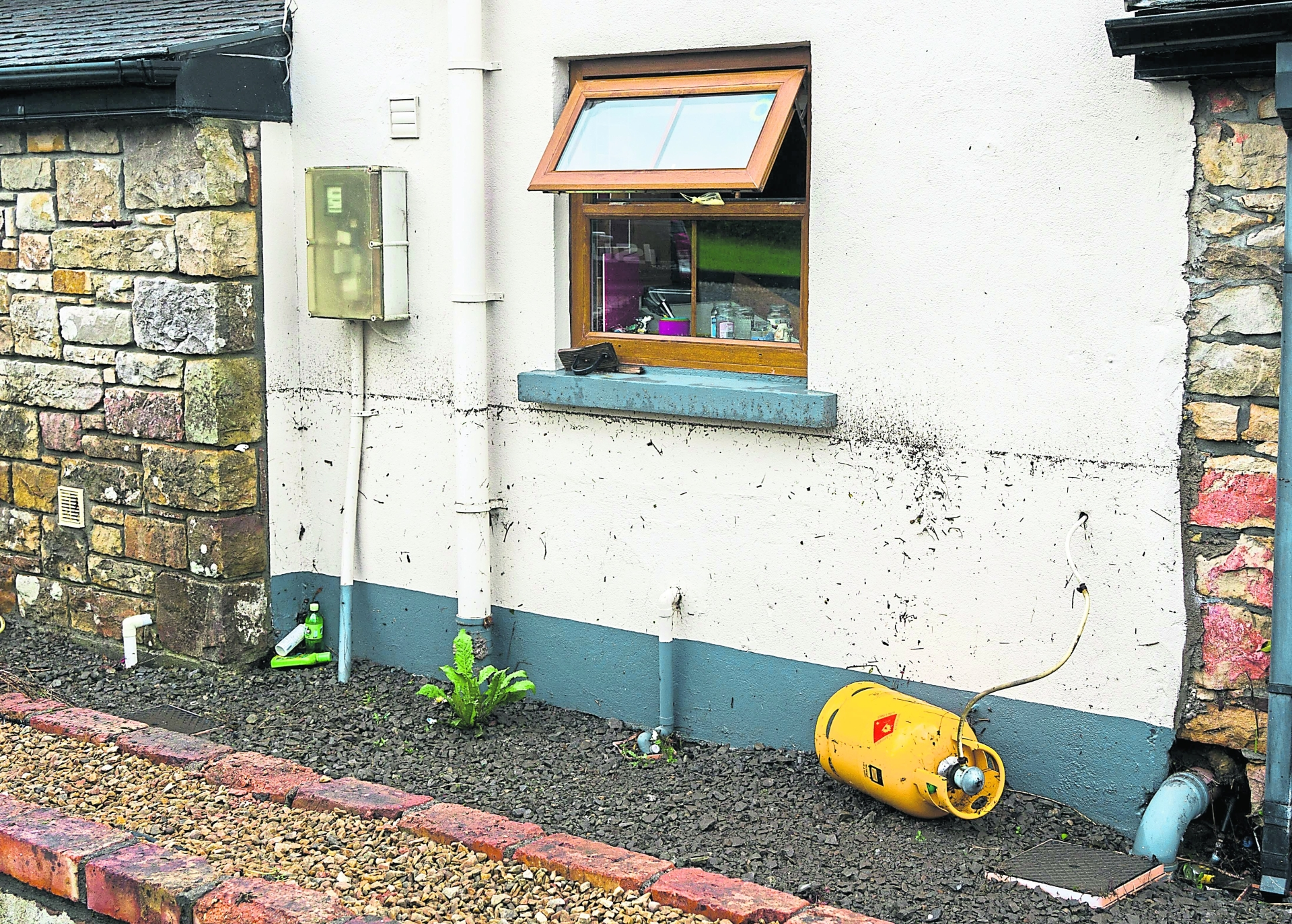 The height of the water along the outside wall in Ballinaglera. Picture Gerry Faughnan